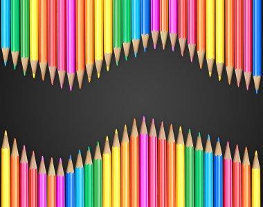 Set of coloured pencils on black background