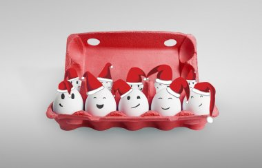 Group of happy eggs dressed in Santa-Claus red-white hats. Ten white eggs in a carton box with smiling faces representing a social network. On a gray background stock vector