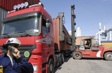 Forklift, truck and workers