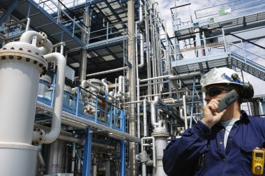 Industry worker and oil refinery