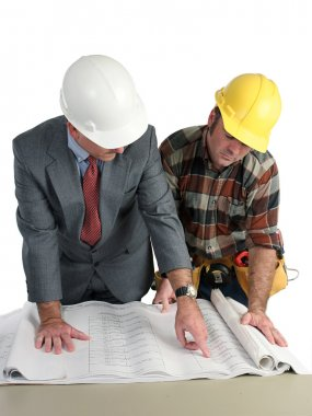 An engineer and a construction foreman reviewing blueprints - isolated stock vector