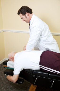 Chiropractor Adjusts Senior Man