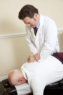 Senior Man with Chiropractor