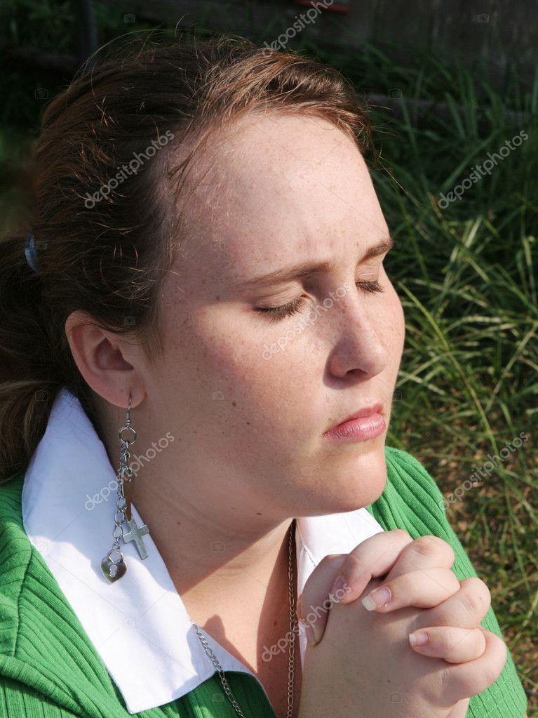 Red Haired Teen Praying