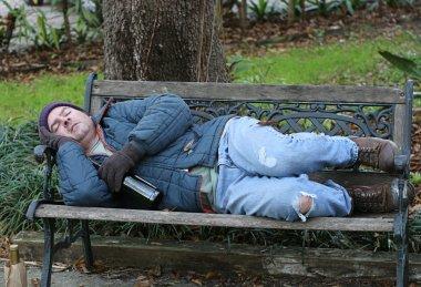 Homeless Man On Bench - Full View