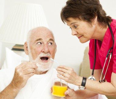 Home Health Nurse - Taking Medicine
