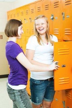 Teenage Girls Gossip by Lockers