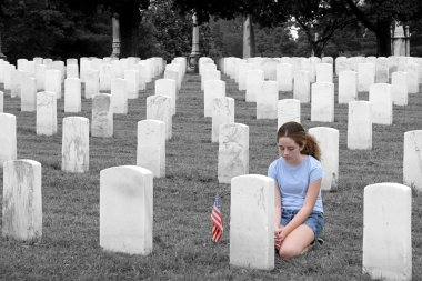 A young girl in a military cemetary honoring a fallen soldier - selective colorization stock vector