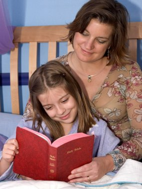 A mother and daughter reading bedtime stories together