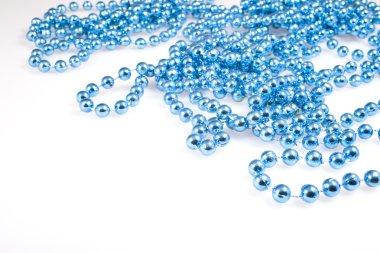 Shining blue beads on white