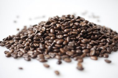 A heap of coffee beans on white background