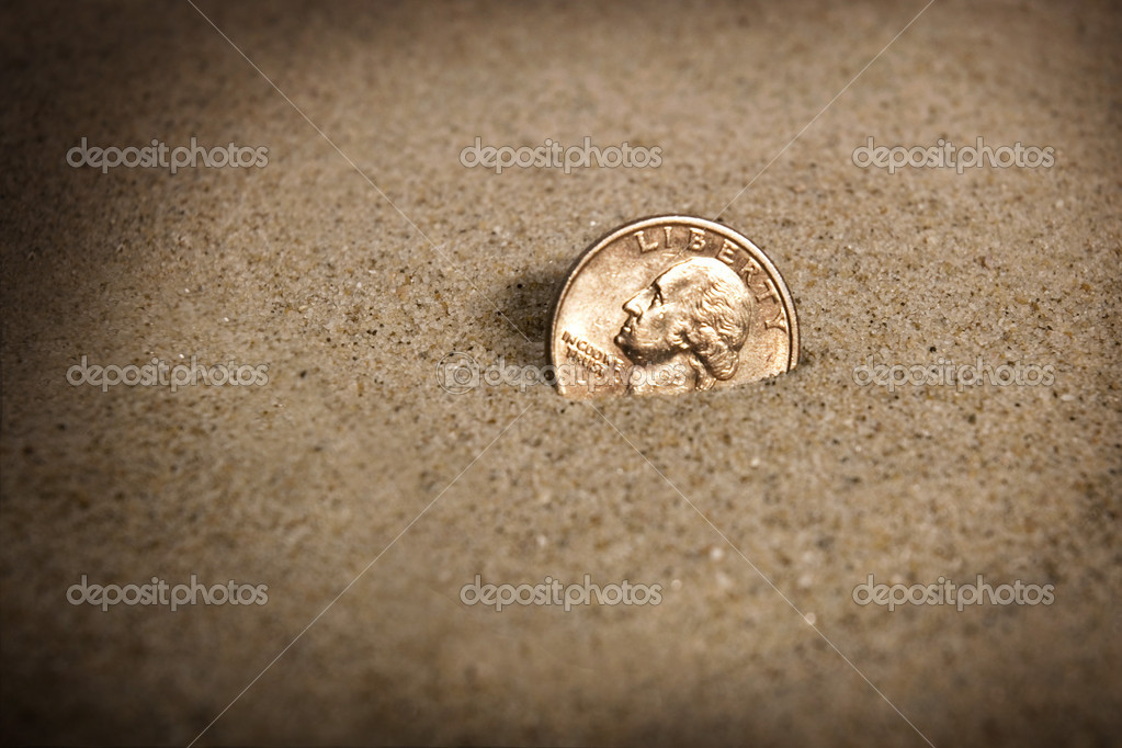 Lost Dollar Coin In Sand On The Beach Concept