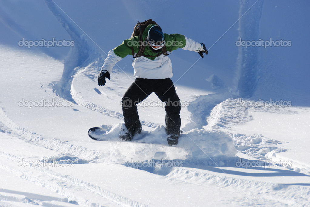 Young Male Snowboarder Jumping
