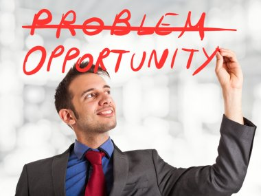 Businessman writing a positive concept