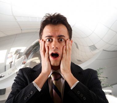 Young businessman shocked