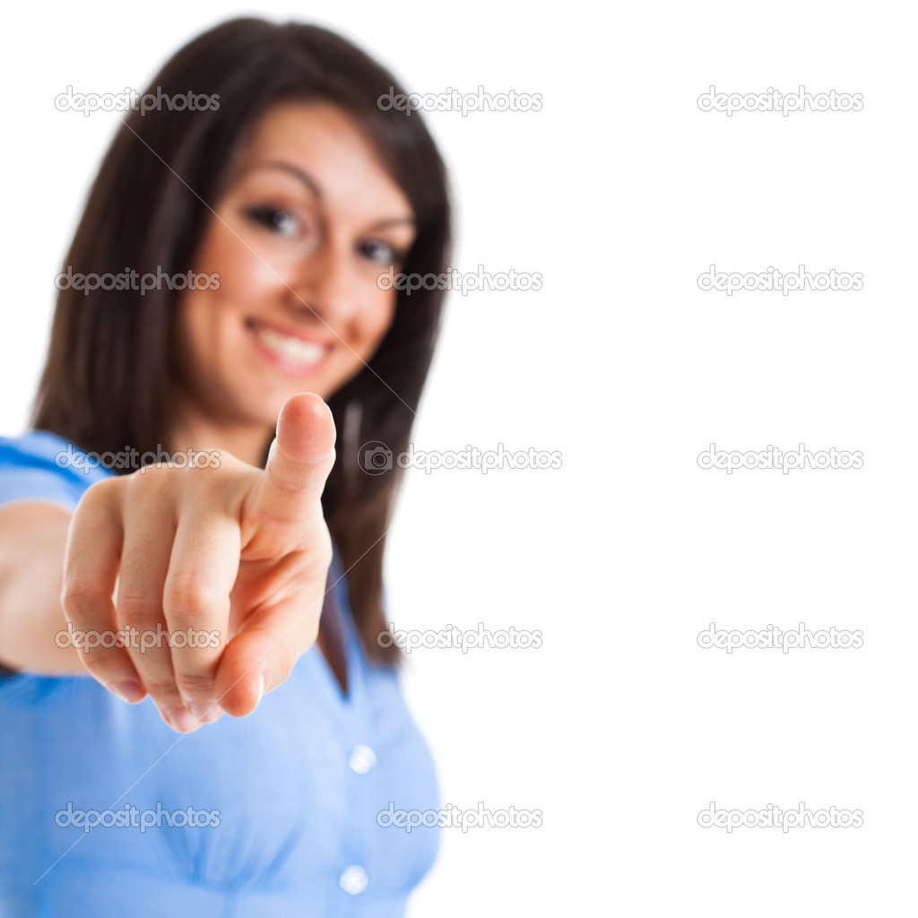 Portrait of a young smiling businesswoman pointing at you. Isolated on white