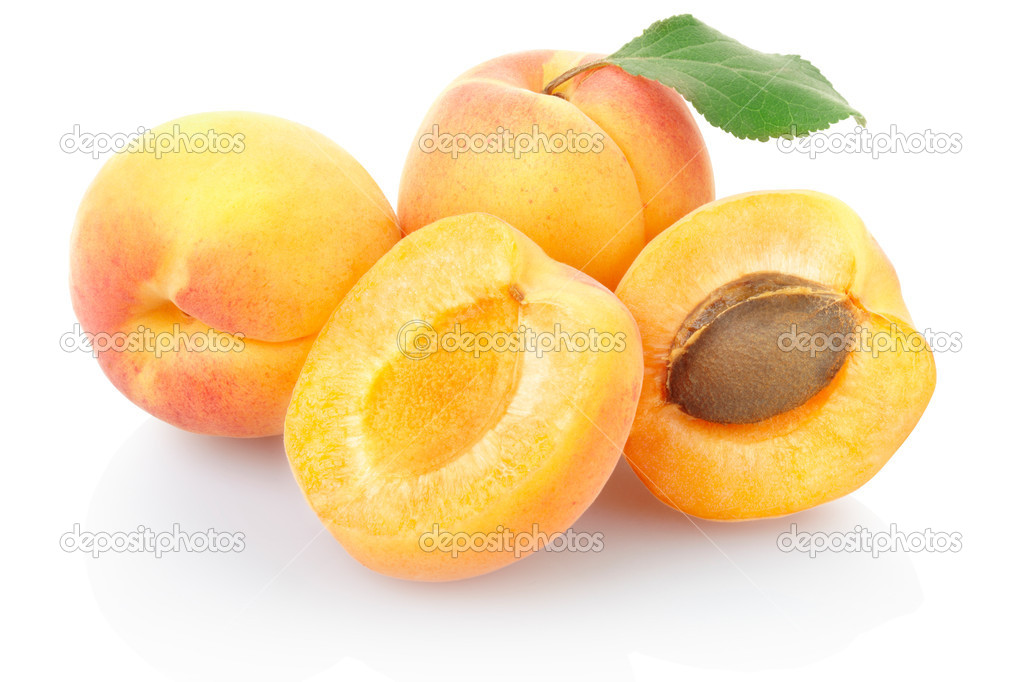 Apricot fruit with leaf isolated on white