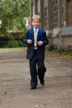 First-form boy goes to school.