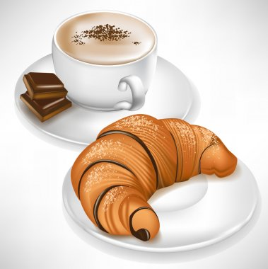 croissant on plate and coffee cup with chocolate pieces
