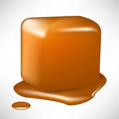 single melted caramel cube isolated