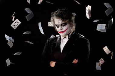 Man in an image of a joker with fly cards