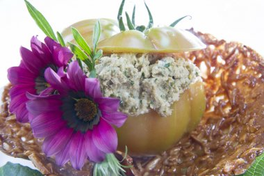 Stuffed tomato with greens