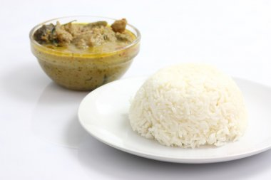 Thai food beef green curry with rice isolated in white backgroun