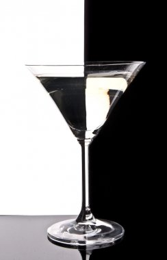 Martini glass on black and white background