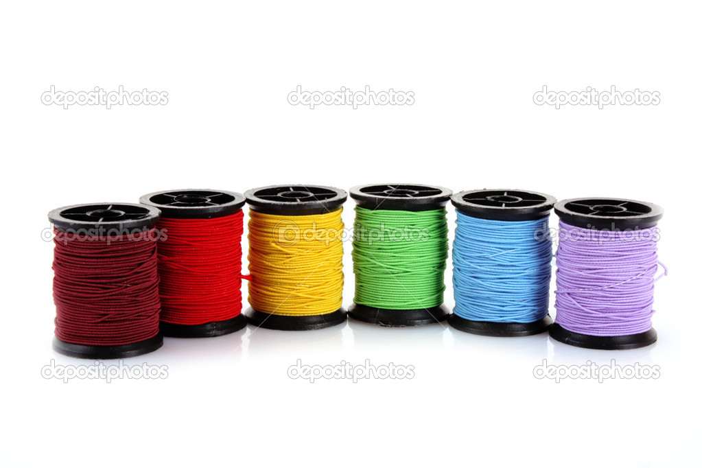 Coloured bobbins of thread isolated on white