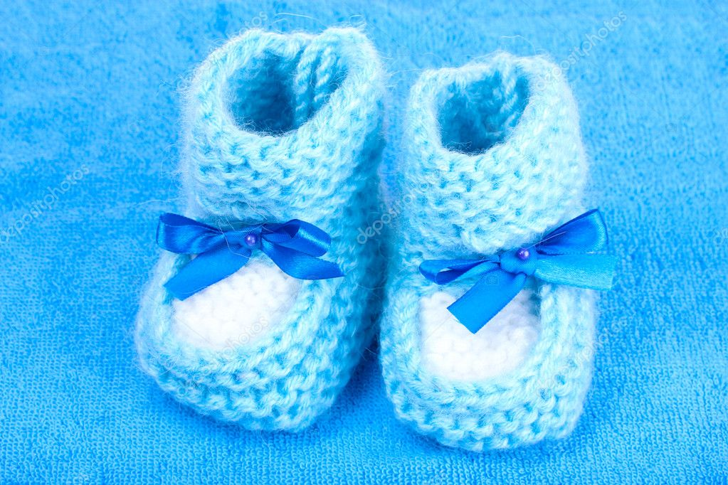 4a3e137892d9 Bright baby booties on blue background — Stock Photo © belchonock ...
