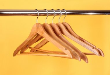 Wooden coat hangers on a clothes rail