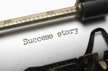 The typed words Success Story on an old typewriter stock vector