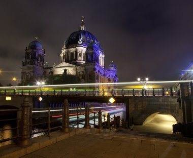 Light Trails from Boats and Buses Passing by the Berliner Dom in