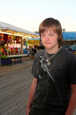 Sad Teen On Festive Boardwalk