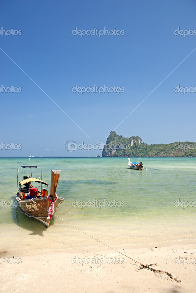 Boat on tropical ko phi phi beach in thailand