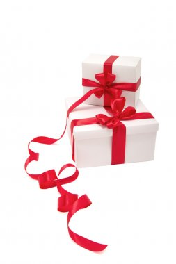 Two white gifts with red ribbons