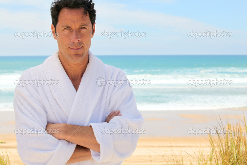 Man on the beach in bath robes — Stock Photo © photography33 #7375005
