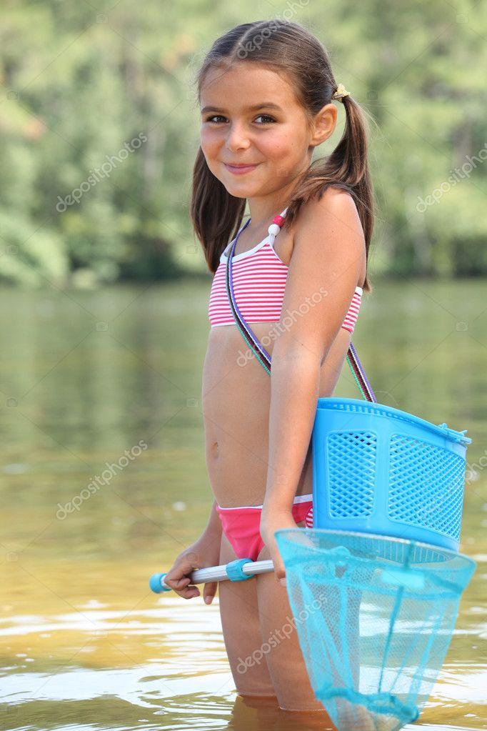 Cute little girl fishing in river — Stock Photo ...
