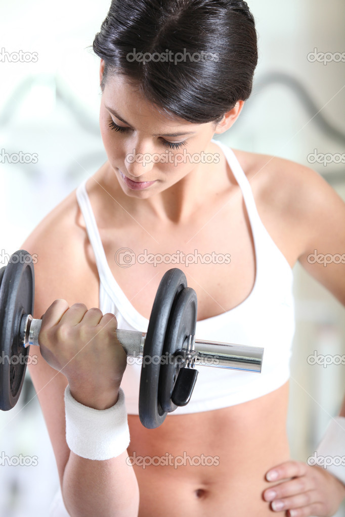 4e90aa6b47fc7 Girl in sports bra lifting barbell — Stock Photo © photography33 ...