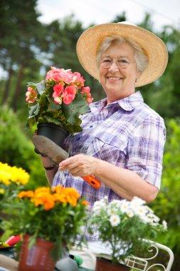 Portrait of pretty senior woman gardening