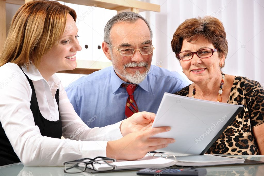 Senior couple meeting with financial advisor