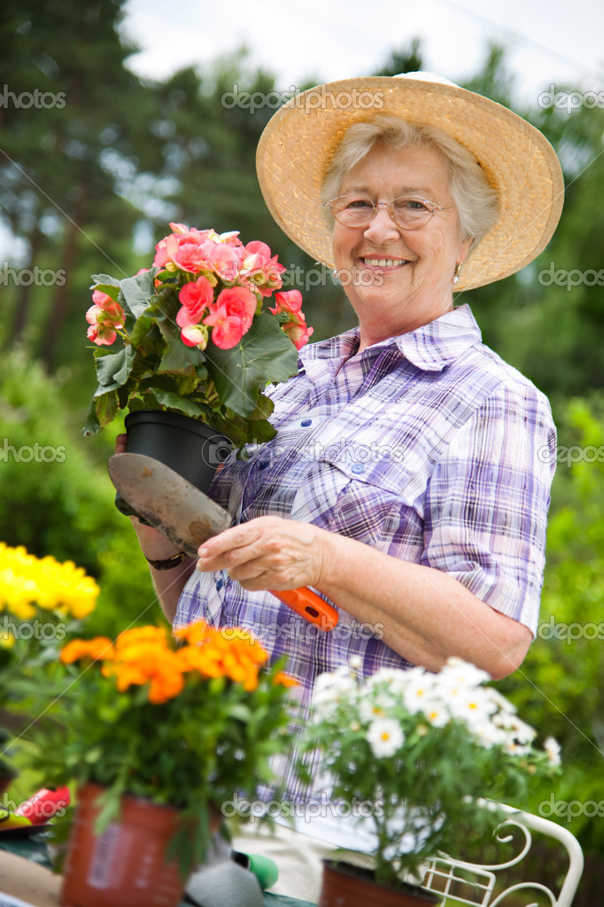 Portrait of pretty senior woman gardening