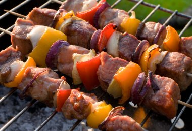 Kabobs grilled with vegetables on skewers