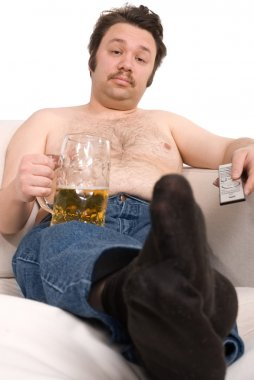 Overweight man with a beer glass