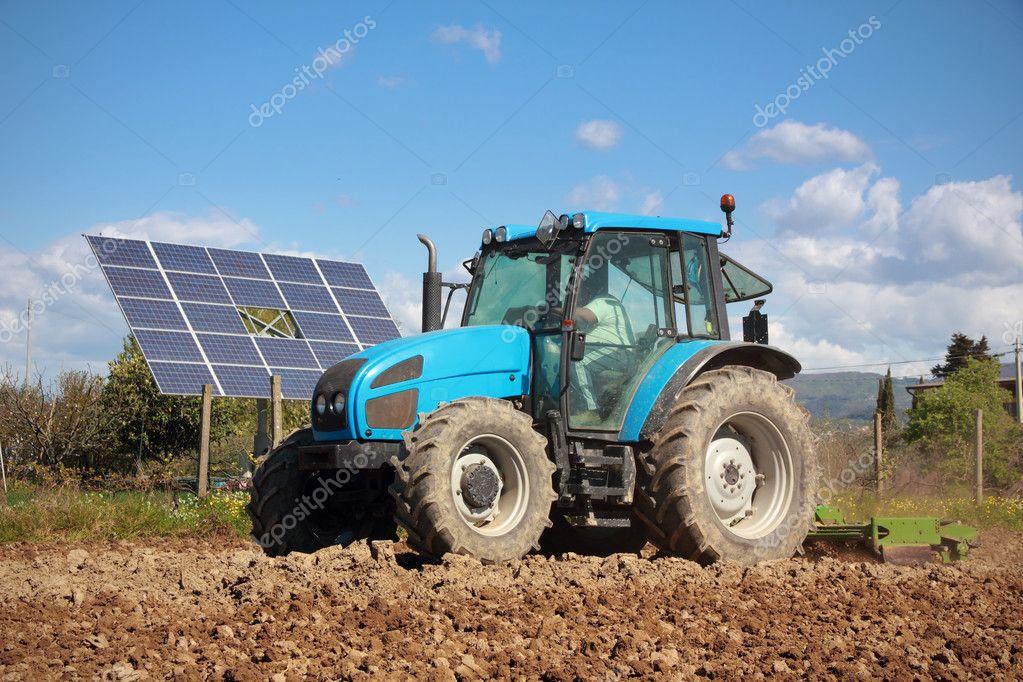 Tractor farming in field