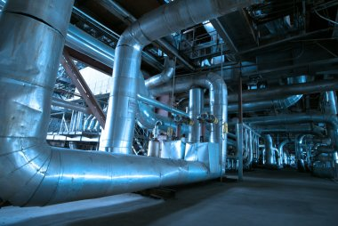 Pipes, tubes, pumps and steam turbine at a power plant