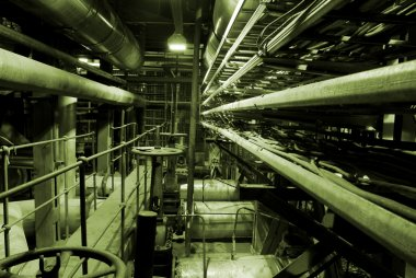 Boilers, ladders and pipes at a power plant,
