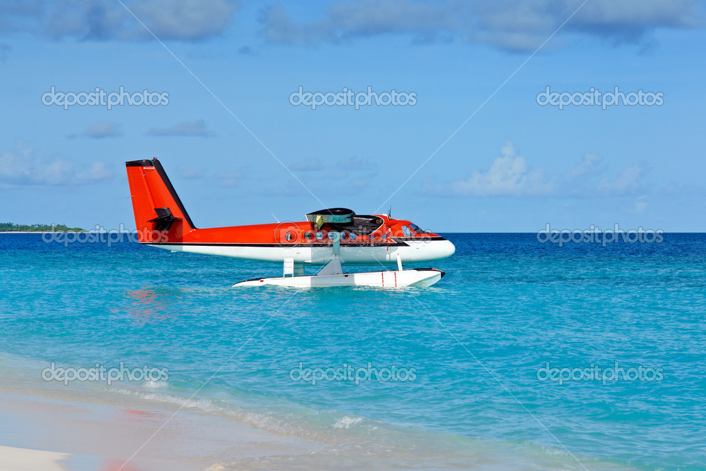 Seaplane anchoring on the beach