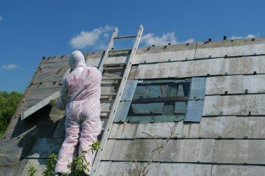 Asbestos removal worker