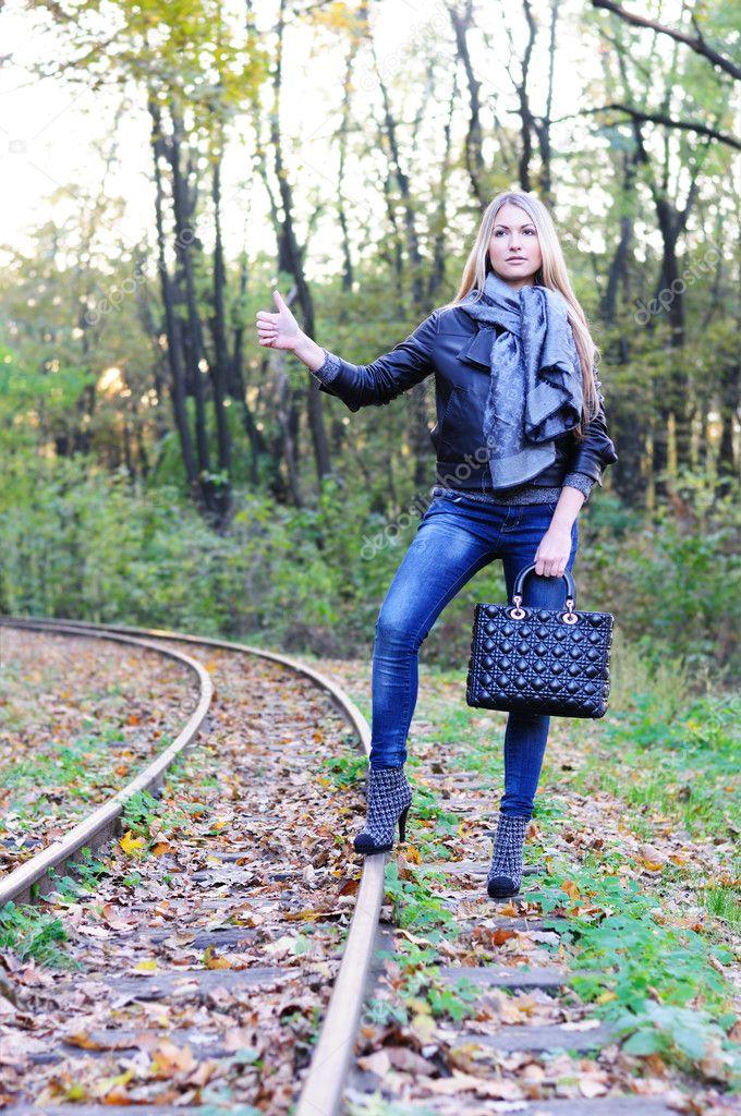 Fall woman on a railroad